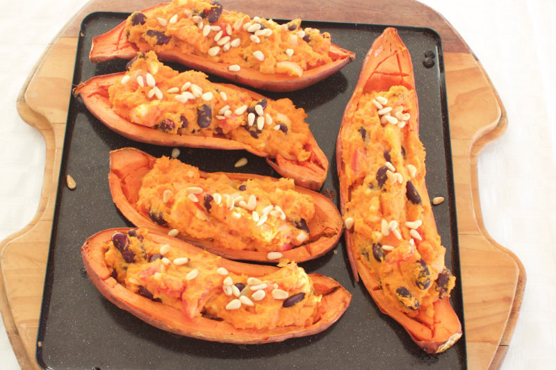 Crispy sweet potato skins filled with creamy, cheesy sweet potato mash and beans. These can be eaten as a filling snack or a full meal.