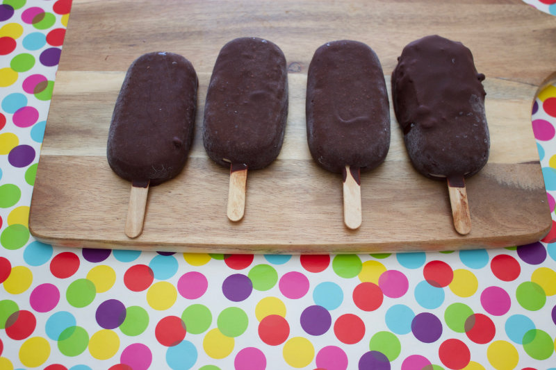four coconut chocolate ice creams on a board